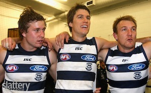 Mitch Duncan, Andrew Mackie and Darren Milburn of the Cats celebrate