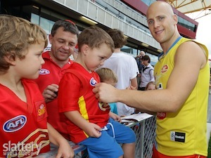 Gary Ablett signs autographs for fans during the opening of Metricon Stadium, Gold Coast.