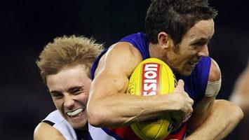 Western Bulldogs' Robert Murphy attempts to shrug a tackle