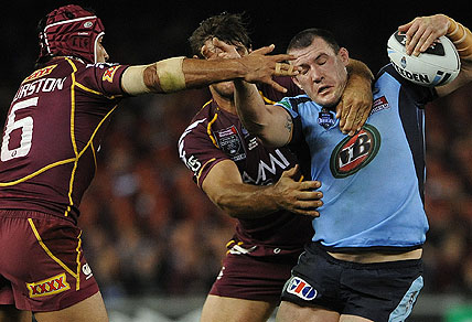 Paul Gallen is tackled by Queensland player Jonathon Thurston. AAP Image/Julian Smith