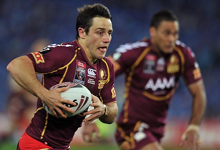 Queensland's Darius Boyd (left) makes a break against New South Wales during game 2 of the State of Origin Rugby League series in Sydney on Wednesday, June 13, 2012. AAP Image/Paul Miller