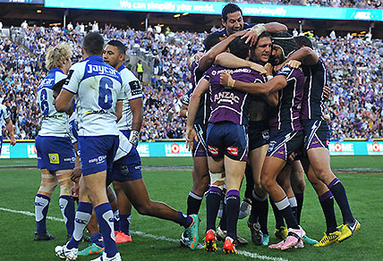 The Melbourne Storm's Ryan Hoffman (right) is congratulated after scoring a try against the Canterbury-Bankstown Bulldogs during the NRL Grand Final at ANZ Stadium in Sydney on Sunday, Sept. 30, 2012. (AAP Image/Paul Miller)
