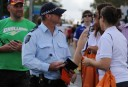 A South Australian policeman collecting his L'Oréal gift bag