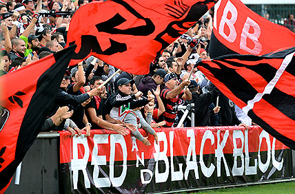 Western Sydney Wanderers' fan group the Red and Black Bloc during the Wanderers v Perth Glory round 22 A-League match at Parramatta Stadium in Sydney, Saturday, Feb. 23, 2013. (AAP Image/Dean Lewins)