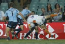 Sarel Pretorius of the Cheetahs is lifted in a tackle by the Waratahs. (Photo: Paul Barkley/LookPro)