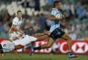 Peter Betham of the NSW Waratahs on his way to score a try. (Photo: Paul Barkley/LookPro)