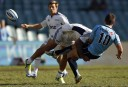 Rene Ranger of the Blues puts a big hit on Bernard Foley of the NSW Waratahs. (Photo: Paul Barkley/LookPro)