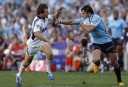 Adam Ashley-Cooper of the NSW Waratahs fends off a Blues defender. (Photo: Paul Barkley/LookPro)