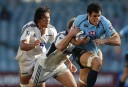 Dave Dennis of the NSW Waratahs attempts to break free of the Blues defence. (Photo: Paul Barkley/LookPro)