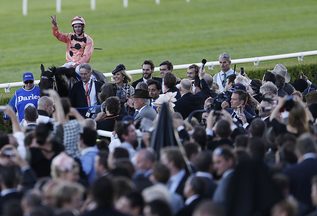 Luke Nolan salutes the crowd after Black Caviar wins an historic race at Derby Day Randwick. (Photo: Paul Barkley/LookPro)