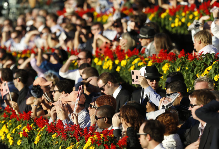 Punters bask in the sun during Derby Day at Randwick. (Photo: Paul Barkley/LookPro)