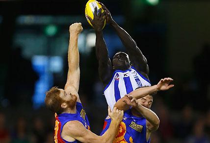 Majak Daw of the Kangaroos sensationally marks the ball