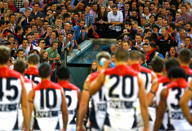 The Melbourne Demons face an angry crowd
