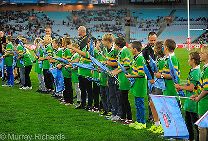 Rugby players from Avoca Beach Rugby, Kiama Rugby and Bowral Rugby form a guard of honour at the Waratahs-Brumbies game. (Image: Murray Richards).