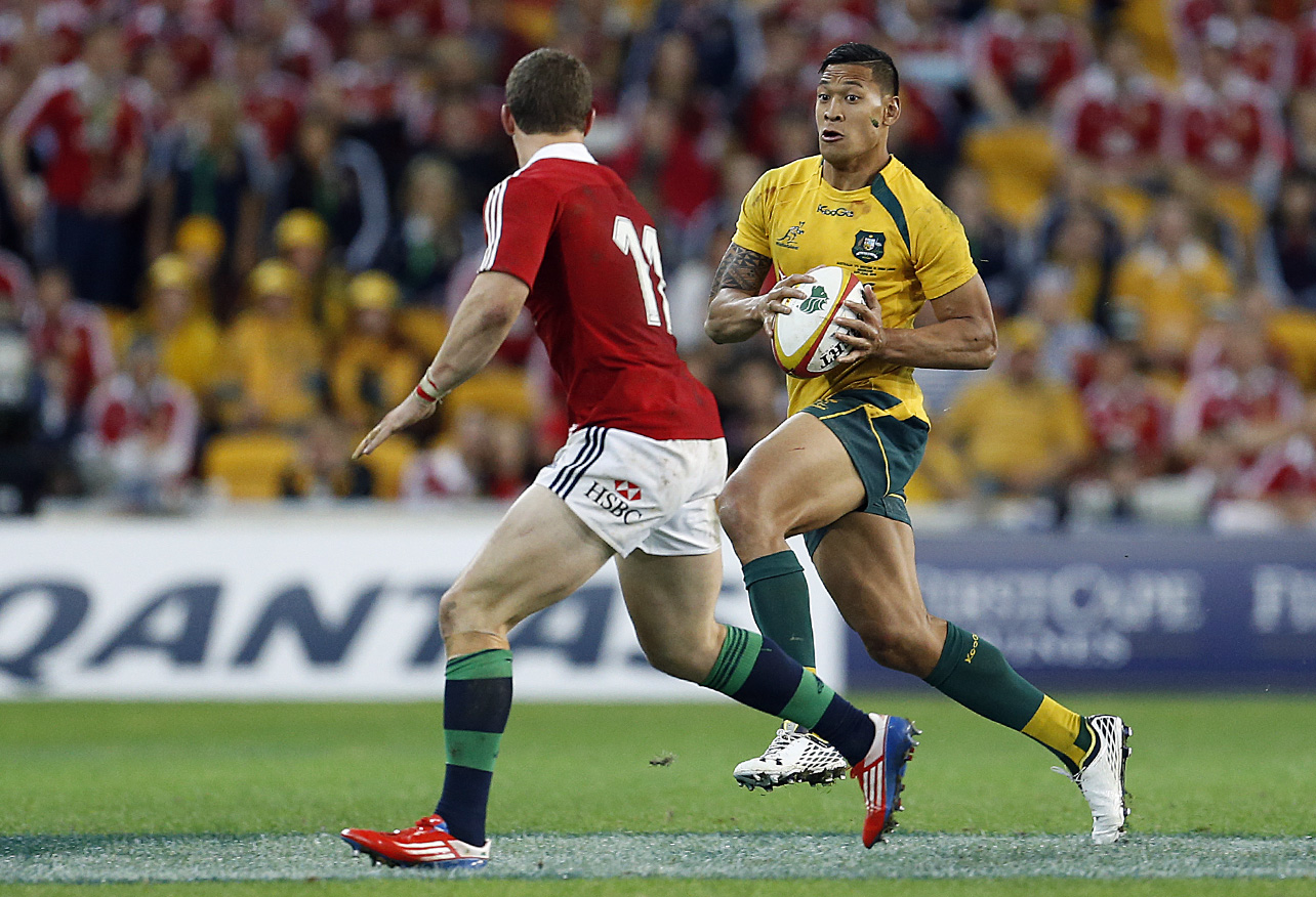 Israel Folau of the Wallabies goes up against George North of the Lions.