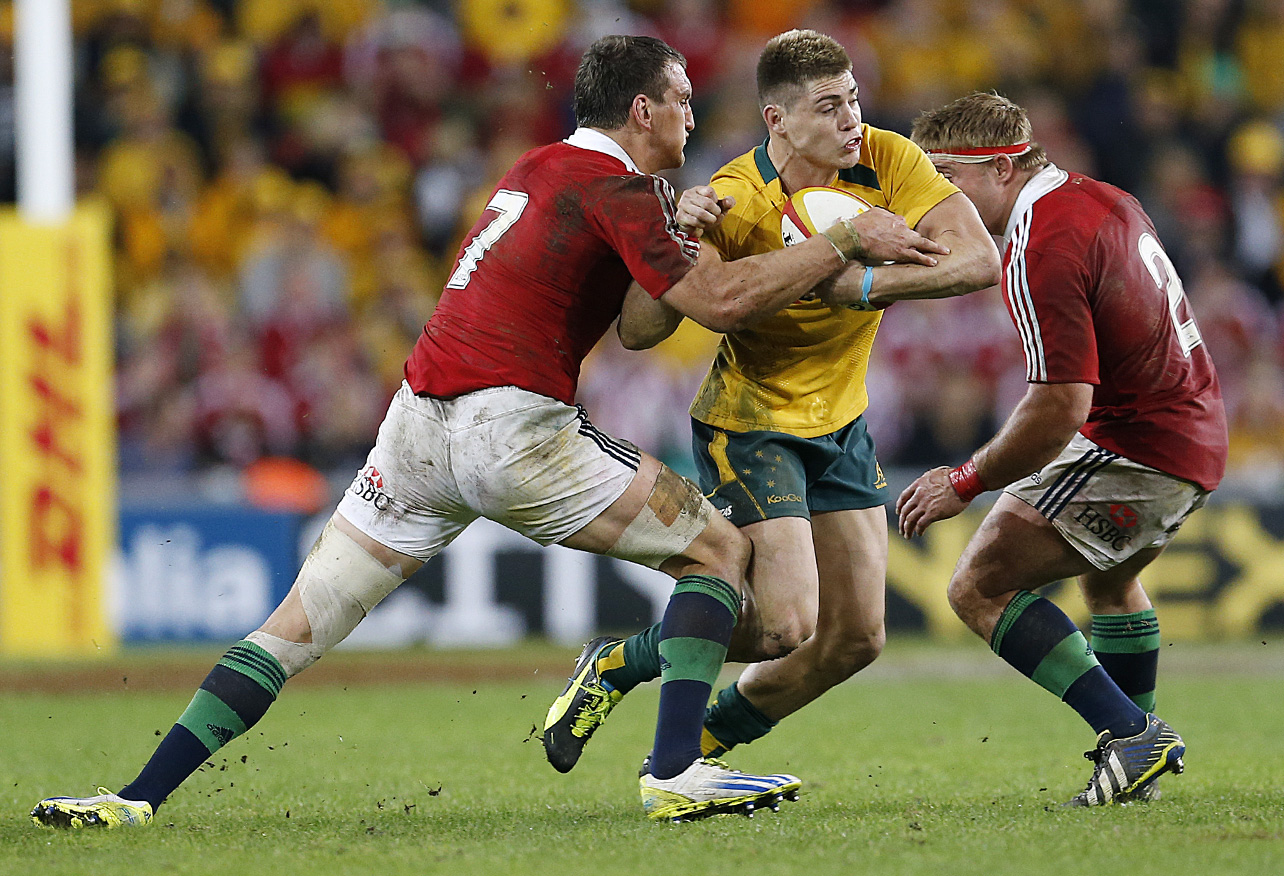 James O'Connor of the Wallabies tries to beat Sam Warburton and Tom Youngs of the Lions. (Photo: Paul Barkley/LookPro)