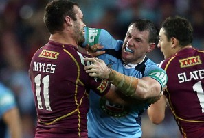 Paul Gallen (c) and Nate Myles fight during the opening match of the 2013 State of Origin.