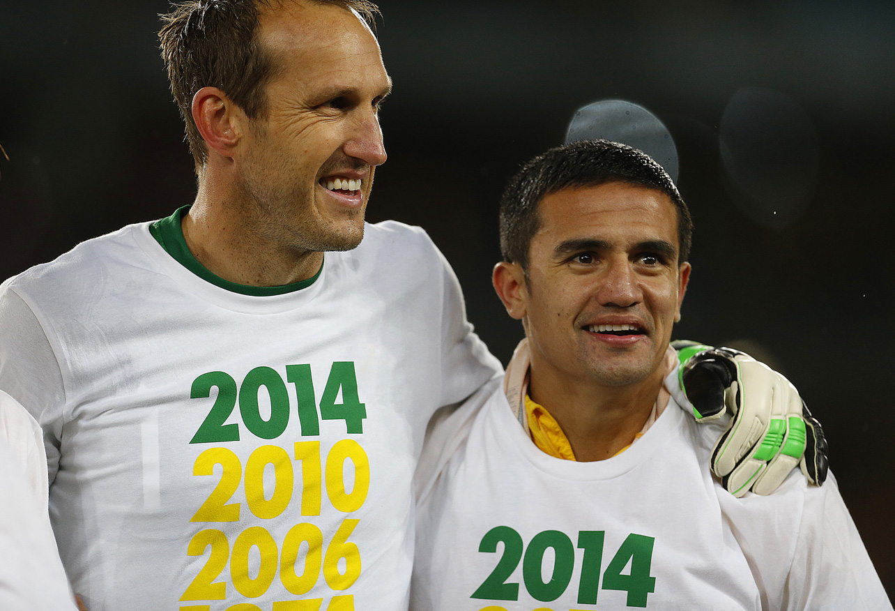 Mark Schwarzer and Tim Cahill after beating Iraq. (Photo: Paul Barkley / LookPro)