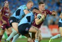 Queensland Maroons' Brent Tate is tackled by NSW Blues Andrew Fifita and Luke Lewis during 2013 State of Origin Game 3 (AAP Image/Dean Lewins)