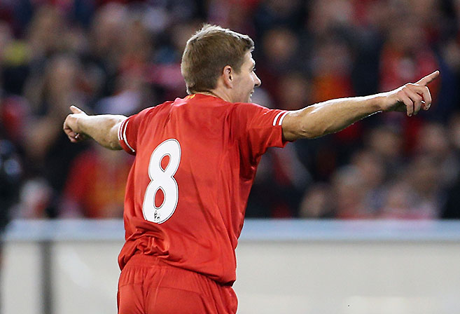 Liverpool captain Steven Gerrard celebrates the opening goal during the 2013 pre-season tour match of Liverpool FC against Melbourne Victory at the MCG in Melbourne. (AAP Image/Mark Dadswell)