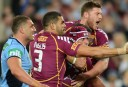 Queensland players celebrate a try by Johnathan Thurston (centre) during 2013 State of Origin Game 3 (AAP Image/Dean Lewins)