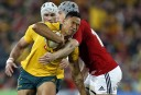 Israel Folau of the Wallabies runs into a shoulder from Jonathan Davies of the Lions. (Photo: Paul Barkley/LookPro)