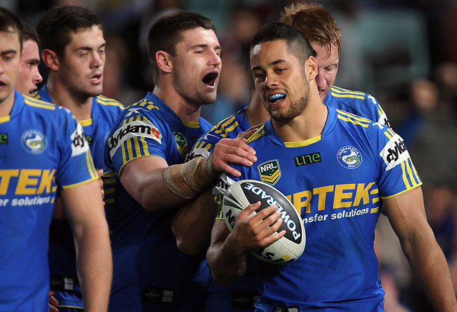Jarryd Hayne is congratulated by his team mates. (AAP Image/Action Photographics, Robb Cox)