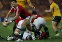 Mike Phillips of the Lions passes from the ruck. (Photo: Paul Barkley/LookPro)