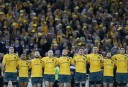 Wallabies players sing the national anthem before the start of the match. (Photo: Paul Barkley/LookPro)