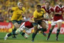 Will Genia of the Wallabies shapes to pass. (Photo: Paul Barkley/LookPro)