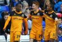 Hull City striker Sone Aluko celebrates with team-mates