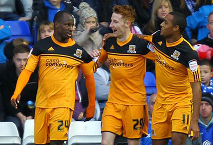 Hull City striker Sone Aluko celebrates with team-mates.