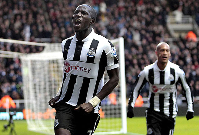 Newcastle United midfielder Moussa Sissoko celebrates a goal.