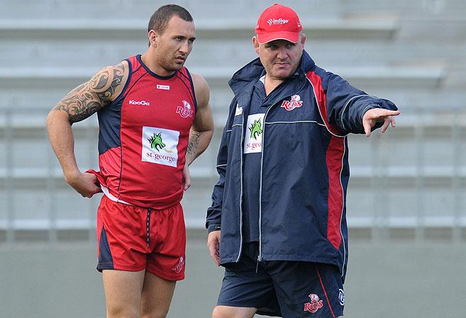 Queensland Reds player Quade Cooper (left) and coach Ewen McKenzie. (AAP Image/Dave Hunt)