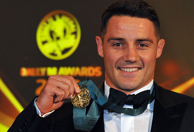 Melbourne Storm player Cooper Cronk poses with the Dally M medal at the 2013 NRL Dally M Awards at The Star in Sydney, Tuesday, Oct. 1, 2013. (AAP Image/Paul Miller)