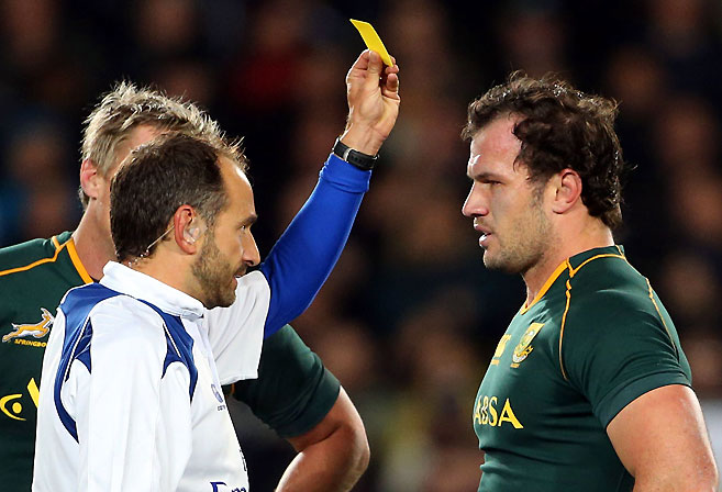 Bismarck du Plessis of South Africa (R) is yellow-carded by referee Romain Poite (L) during the Rugby Championship Test rugby union match between the New Zealand All Blacks and South Africa at Eden Park. AFP PHOTO / Michael Bradley