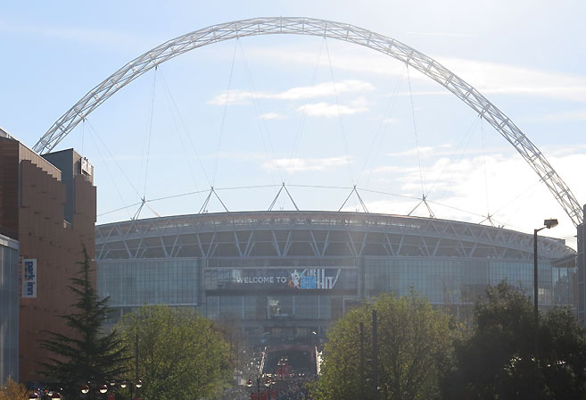 The exterior of Wembley Stadium, in the sun