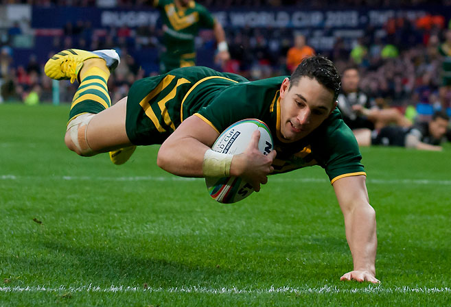 Australia's Billy Slater dives on the grass to score a try