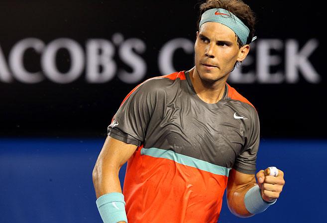 Rafael Nadal pumps his fist in win against Bernard Tomic