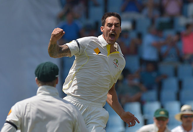 Australia cricketer Mitchell Johnson (C) celebrates after bowling out unseen South Africa's cricketer Graeme Smith, for 10 runs on the second day of the first test match between South Africa and Australia at SuperSport Park in Centurion on February 13, 2014. AFP PHOTO / ALEXANDER JOE