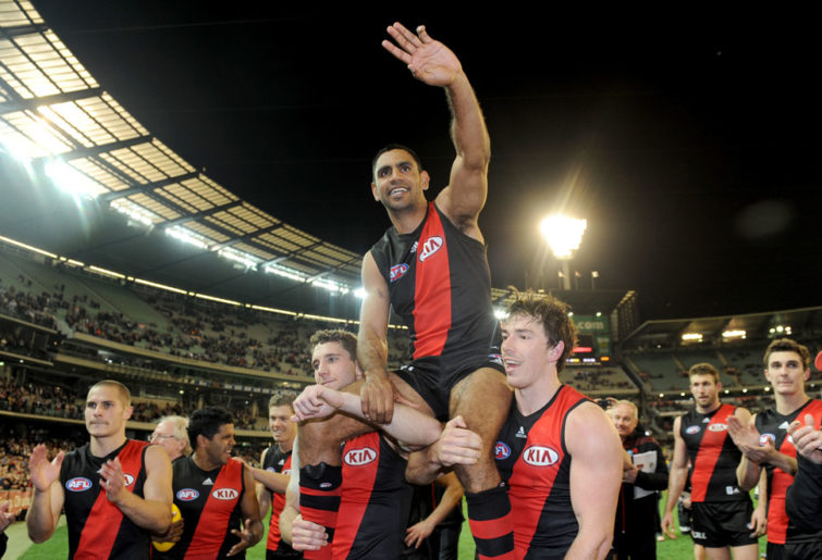Nathan Lovett-Murray of Essendon is carried off the ground by team-mates. (AAP Image/Joe Castro)