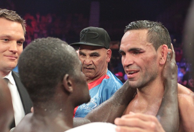 Joshua Clottey embraces Anthony Mundine after the bout (Image: The Roar)