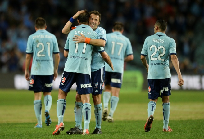 Sydney FCs' Richard Garcia celebrates with teammate Alessandro Del Piero