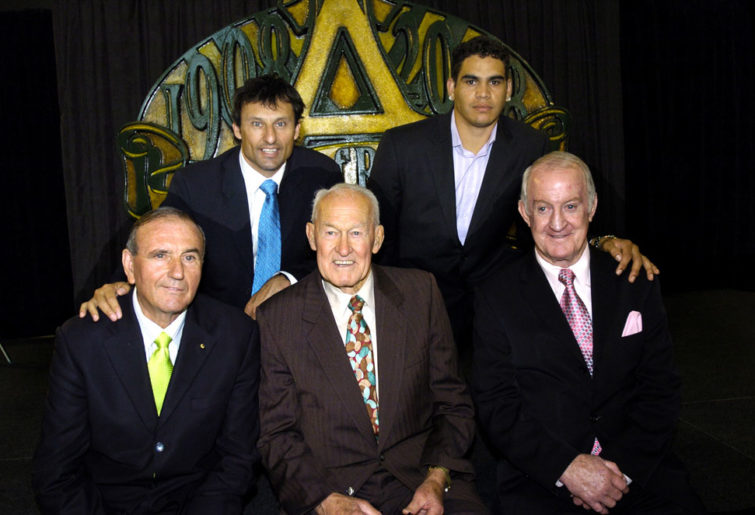 Old and recent Rugby League greats (L-R:) Reg Gasnier, Laurie Daly, Jack Rayner, Gary Inglis and John Raper pose for photographs at the National Museum in Canberra, Monday, Nov. 27, 2006. (AAP Image/Alan Porritt)