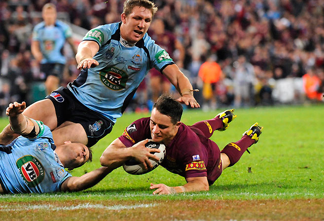 Cooper Cronk scores Queensland's fifth try in a 32-8 defeat of New South Wales in Game 3