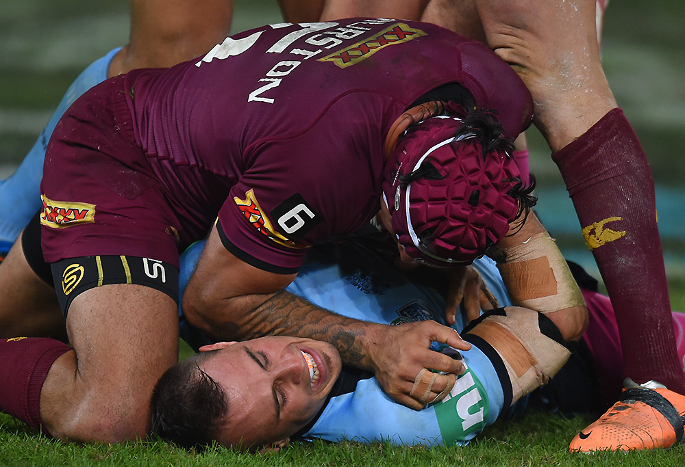 Johnathan Thurston and Josh Reynolds tussle in Origin 2