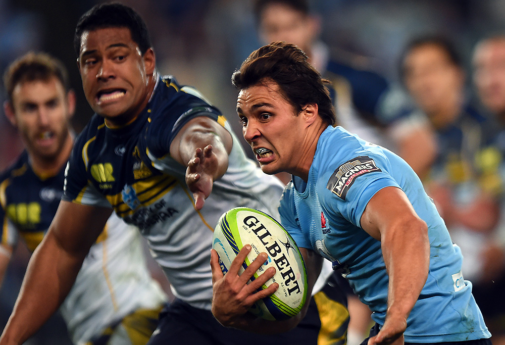 The Waratahs' Nick Phipps makes a break