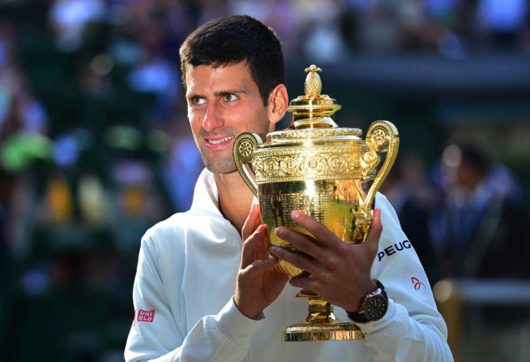 Serbia's Novak Djokovic holds the Wimbledon trophy