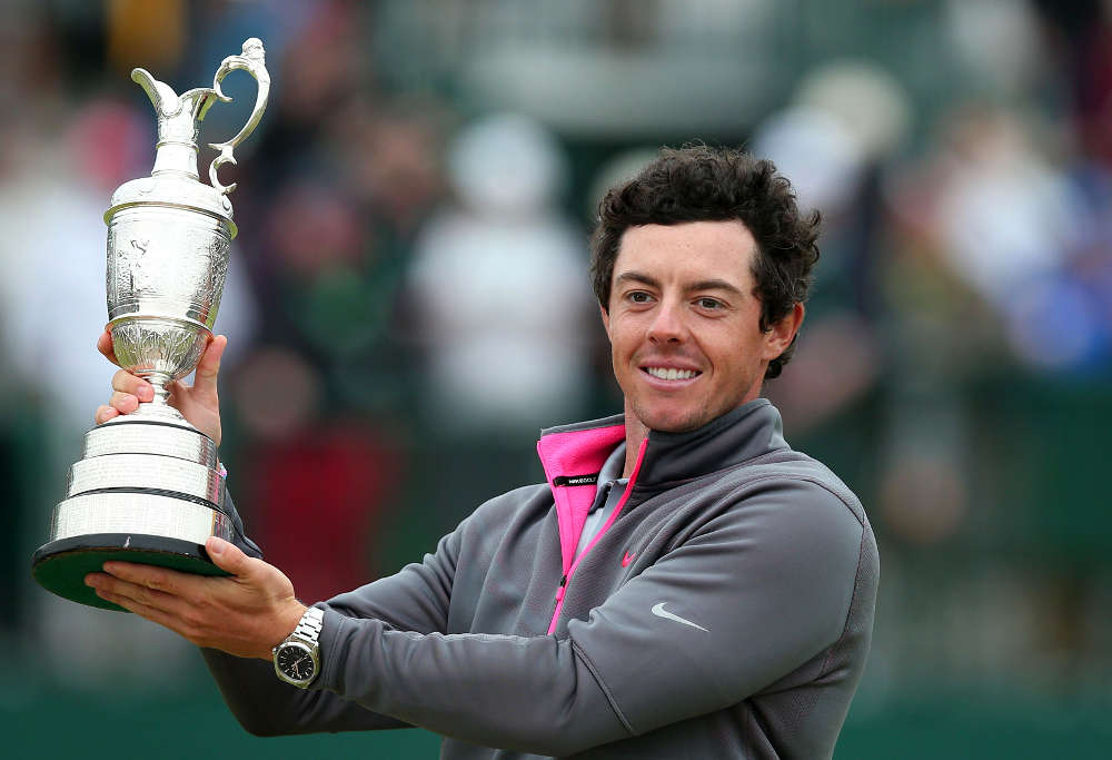 Northern Ireland's Rory McIlroy holds up the Claret Jug after winning the 2014 British Open Golf Championship at Royal Liverpool
