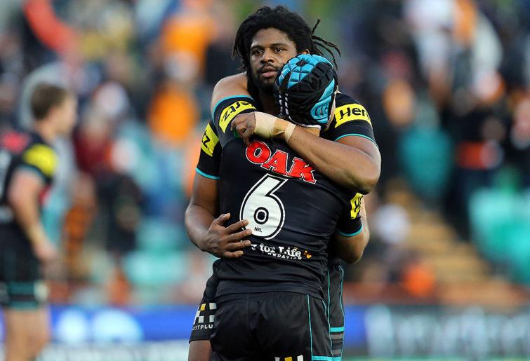 Jamal Idris hugs Jamie Soward